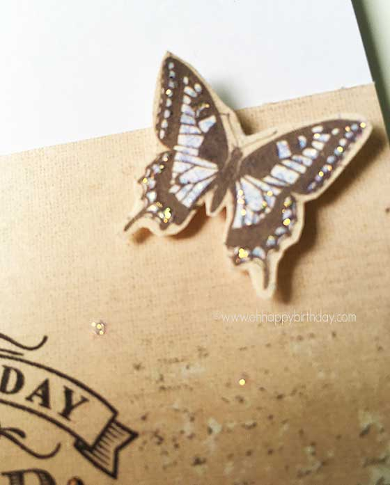 Using glitters on rubber stamped butterfly image.